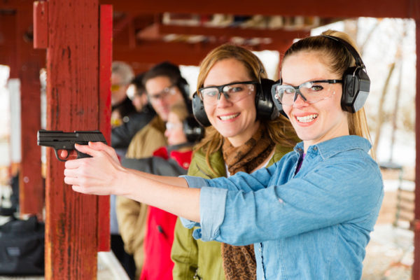 A group of people practicing at the gun range. Photographed on location at a shooting range.